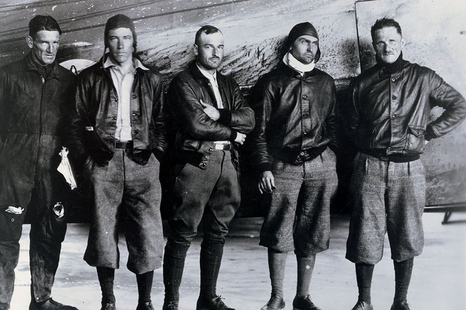 The crew of the Fokker C-2 'Question Mark' poses for a photo after a grueling seven days in the air: (from left) Sergeant Roy Hooe, Lieutenant Elwood 'Pete' Quesada, Lieutenant Harry Halverson, Captain Ira C. Eaker and Major Spaatz. (U.S. Air Force)