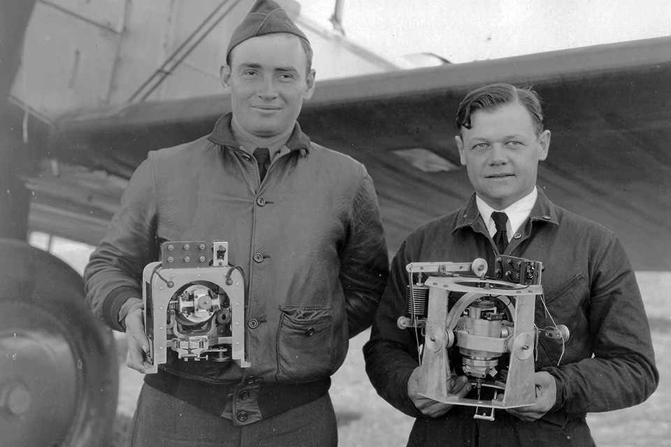 Elmer Jr.—shown at right with Lieutenant Marion Higgins holding gyroscopes used in U.S. Army Air Corps field exercises—dropped out of Cornell University at Lawrence's urging. (Glenn H. Curtiss Museum)