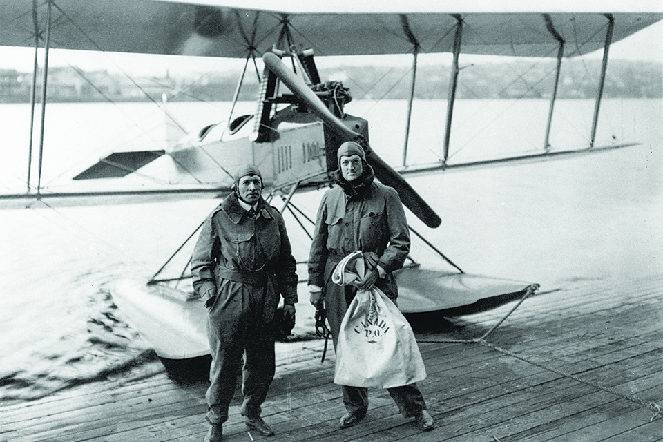 William Boeing (right) and pilot Eddie Hubbard stand before the Boeing C-700 in which they flew the first international airmail run, 120 miles from Vancouver, Canada, to Seattle, Wash., on March 3, 1919. (Library of Congress)